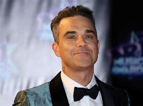 robbie williams tour management placing tickets on resale