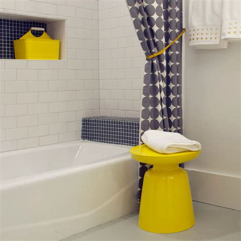 grey yellow bathroom accessories martini side table in a beach house bathroom by rethink