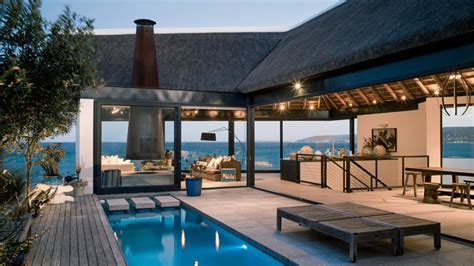 ultra custom home design ta buildings that know how to make a thatched roof look modern
