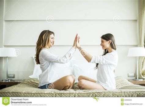 two women in bed young women on the bed stock photo image 52992843