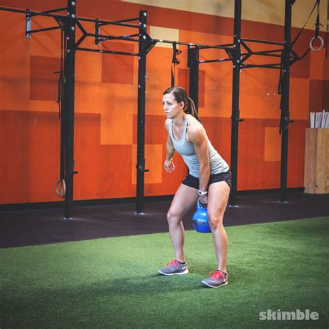 squat swing left kettlebell squat clean thrusters exercise how to