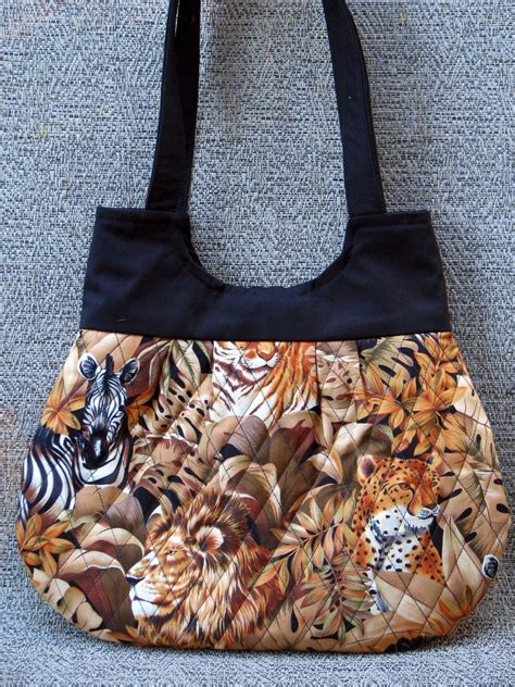 leopards lions  zebra quilted fabric hobo style tans  browns handbag fabric utopia