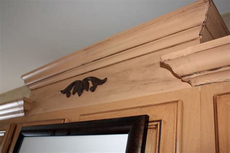 molding on kitchen cabinets i wanted to get a bit fancy and have a staggered look to