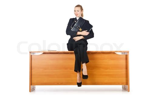 Sit At The Desk by Businesswoman Sitting On The Desk Stock Photo