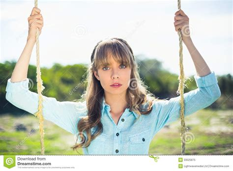 woman on a swing trendy attractive woman sitting on swing royalty free