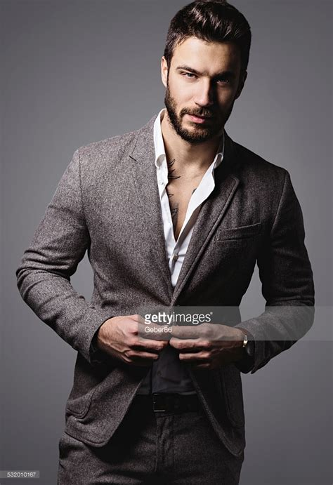 best stock photos of photo handsome man showing cell phone black handsome man stock photo getty images