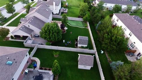 Backyard Subdivision by Aerial View Houses In Residential Suburban Neighborhood With Backyard Landscape And Rooftops