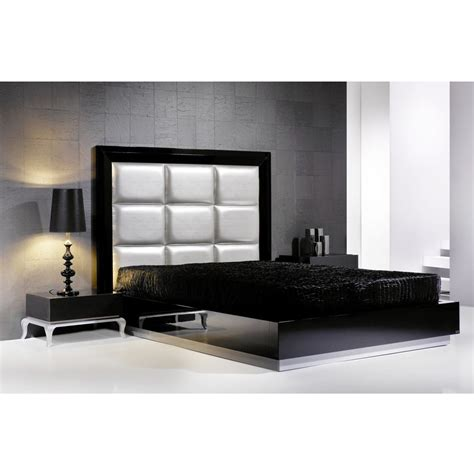 padded headboard and black gloss bedstead