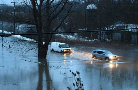 flood alert issued for central ny as rain pours and snow