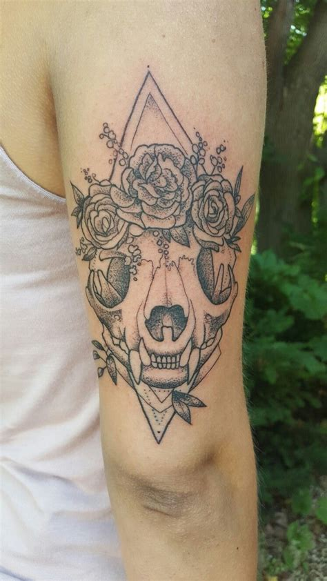 evolution tattoo cat skull rocking a flower crown done by alex gregory