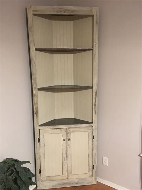 white distressed antique white corner cabinet diy
