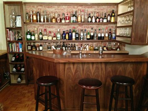 home bar wall decor with classic wooden barstools