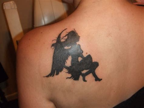 angel silhouette cover up tattoo by trailerparkzombie on