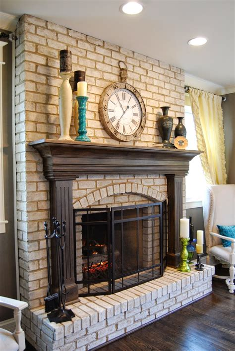 red brick fireplace with white mantel repainted for a cozy