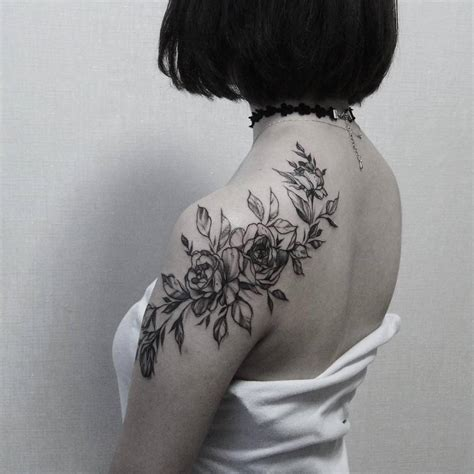 roses covering the shoulde and the shoulder blade