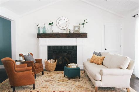 wood beam fireplace mantle living room transitional with