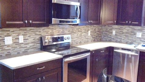 cherry cabinets mosaic backsplash traditional kitchen