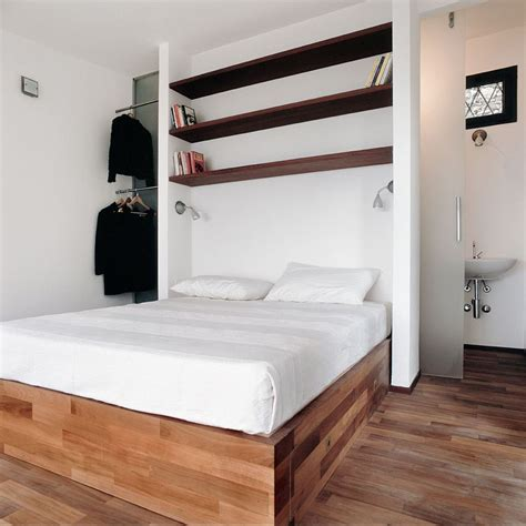 Bed Built Into Floor by Terraced Studio With Storage Built Into The Stepped Floor