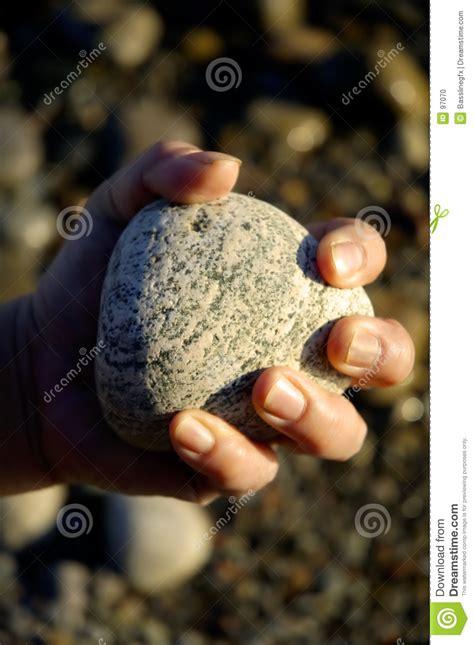 rock  hand closed stock photo image