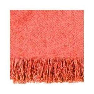 coral colored throw blanket at the end of the bed