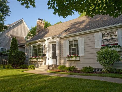 house with white shutters tan siding wellington home improvements profile via guildquality com siding