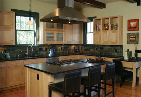 maple cabinets stainless steel appliances and black granite countertops inject a modern look