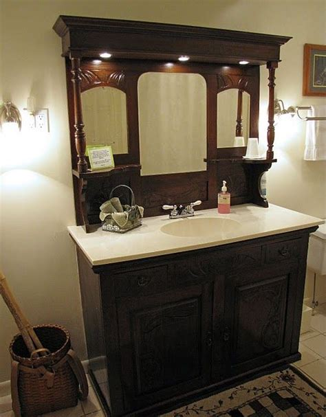 bathroom sink from an antique dresser and fireplace mantel