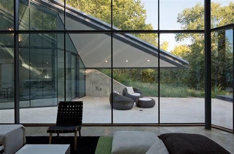 Glass Walls | paneled glass walls of pit house outdoor interior design