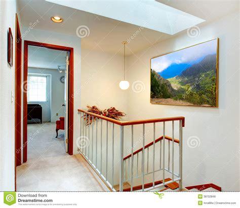 Bedroom Door Opens Into Hallway Bright Hallway View Of Staircase And Bedroom Royalty Free