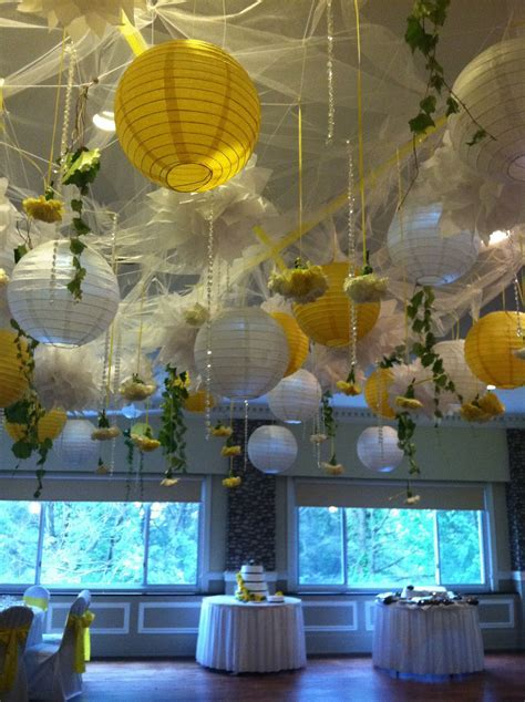 Ceiling decor   tulle, lighted paper lanterns and flowers