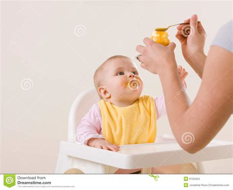 Mother Feeding Hungry Baby In Highchair Stock Images   Image: 6725454
