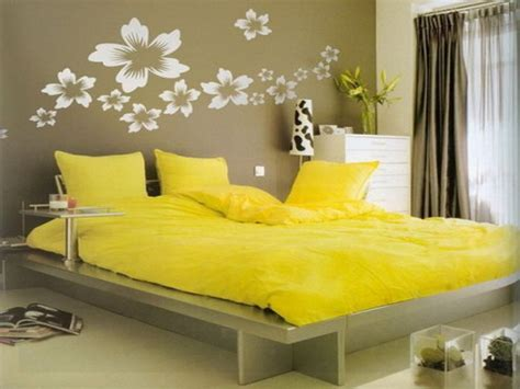 wall decorating ideas for bedrooms wall painting design for bedrooms yellow themed bedroom