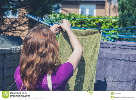hanging laundry hers hanging laundry in garden stock photo image