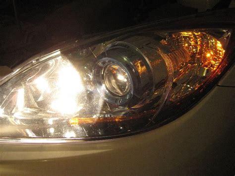 mazda 3 headlight bulb change mazda mazda3 headlight bulbs replacement guide 041