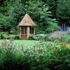 Amid trees and curving beds of ligularia hydrangea and hosta sits a