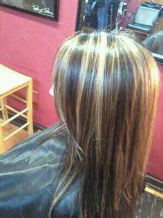 dark hair base with platinum highlights platinum highlights brown blonde and medium brown on