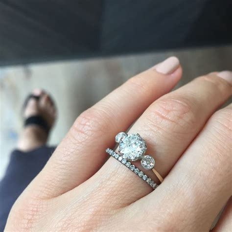 vintage three edwardian engagement ring paired with