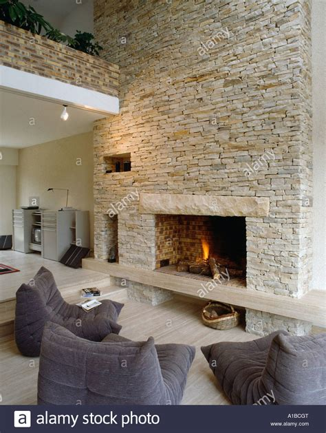 Upholstered Dining Room Chair Lit Fire In Fireplace In Stone Wall Of Barn Conversion