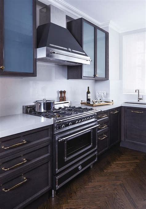 dark gray stained oak cabinets white kitchen with coffee stained kitchen vent hood