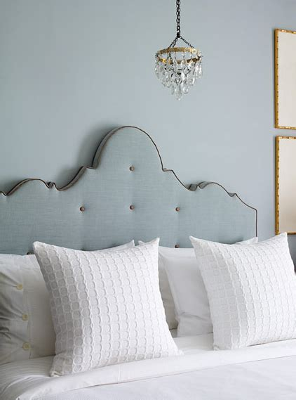 blue upholstered headboard transitional bedroom