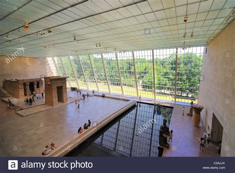 Exhibit At The Metropolitan Museum Of by Temple Of Dendur Exhibit Displays An Ancient