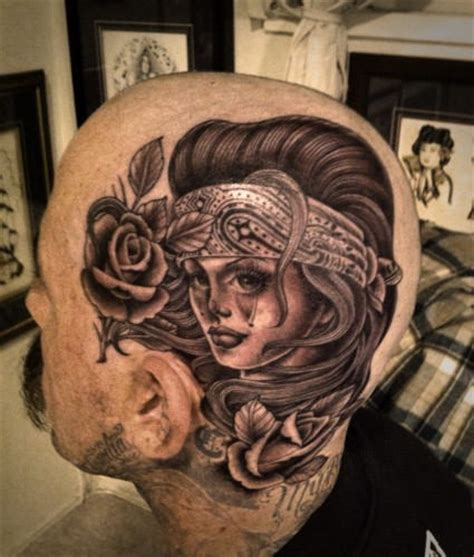 crying woman face tattoo on head