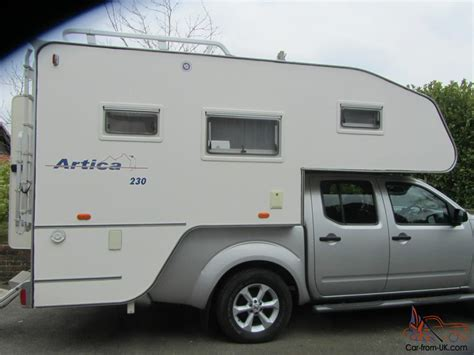 Split Floor Plan nissan navara adventera pick up and american camper back 4