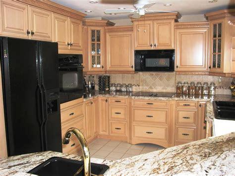 Modern Kitchen With Black Appliances Modern Kitchen With Black Appliances Brown Glass Mosaic Backsplash Norma Budden