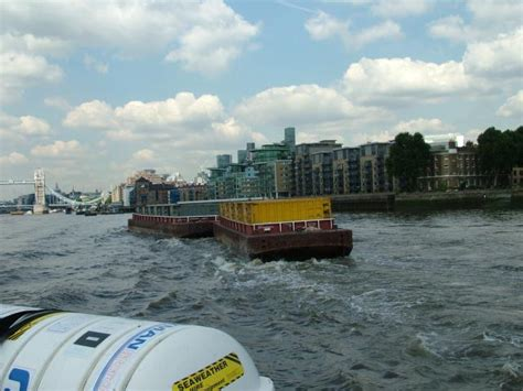 thames river recycling refuse waste being transported along river thames nen