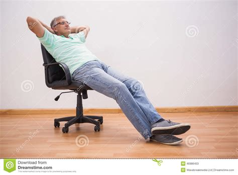 Leaning Back In Chair by Leaning Back In Swivel Chair Stock Photo