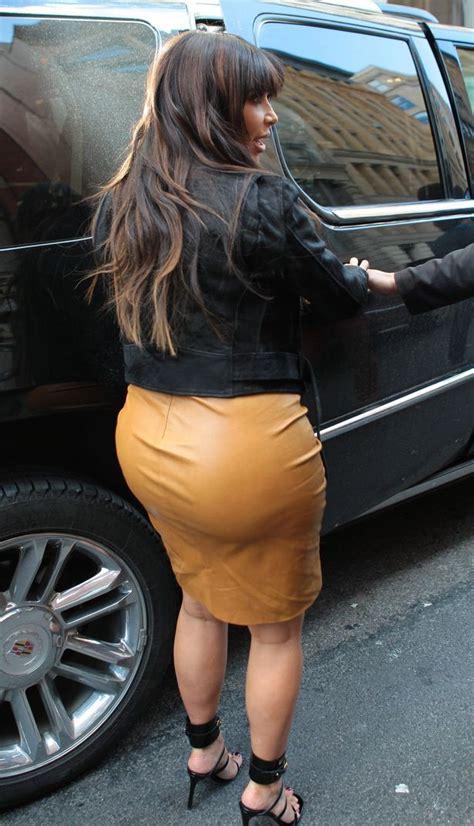 pregnant kim kardashian squeezes    caramel leather