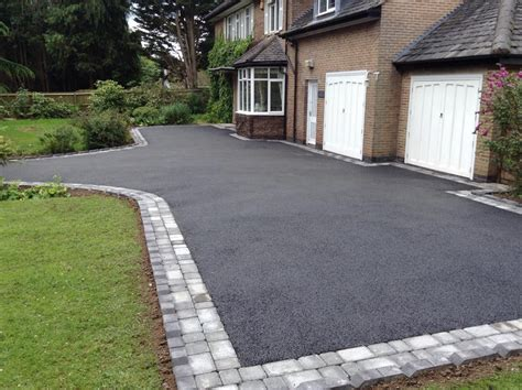 drive uk new driveway in cropston with grey cobble paving and black