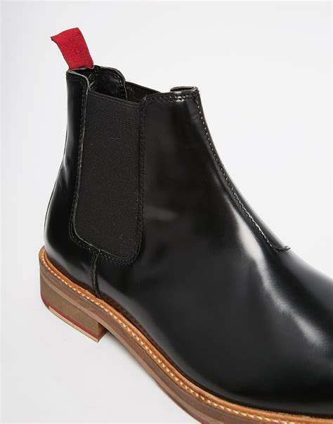 asos chelsea boots in black leather with cleated sole