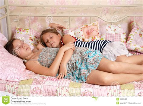 two little girls sleep in a bed stock image image 33337401